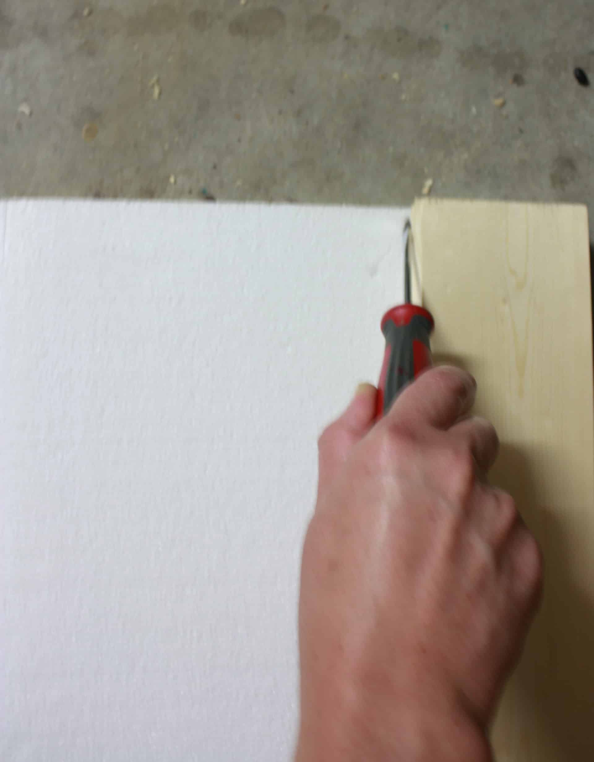 Cutting styrofoam for the wooden floral vase for table decor
