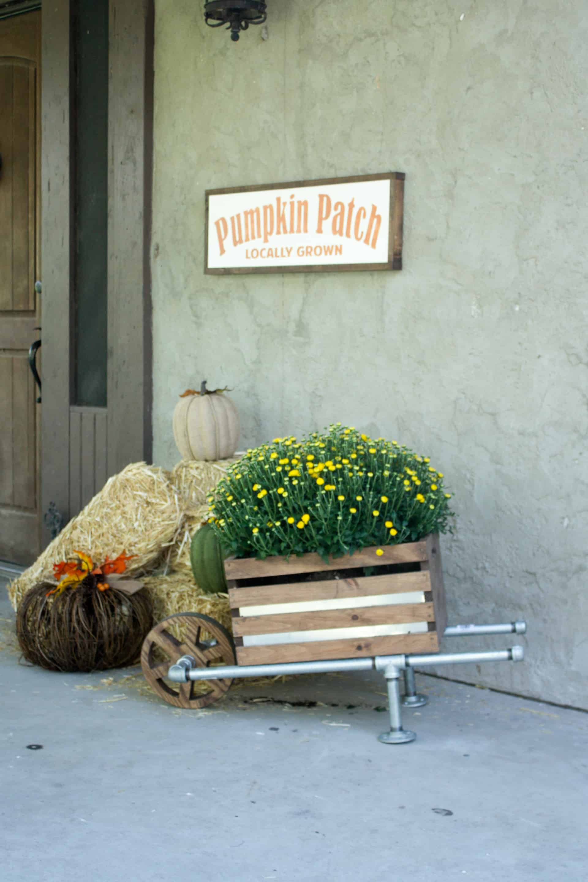 DIY wheelbarrow made of galvanized pipe and a wooden crate