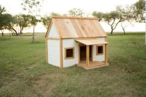 DIY Doghouse - the cutest white and cedar doghouse with free build plans