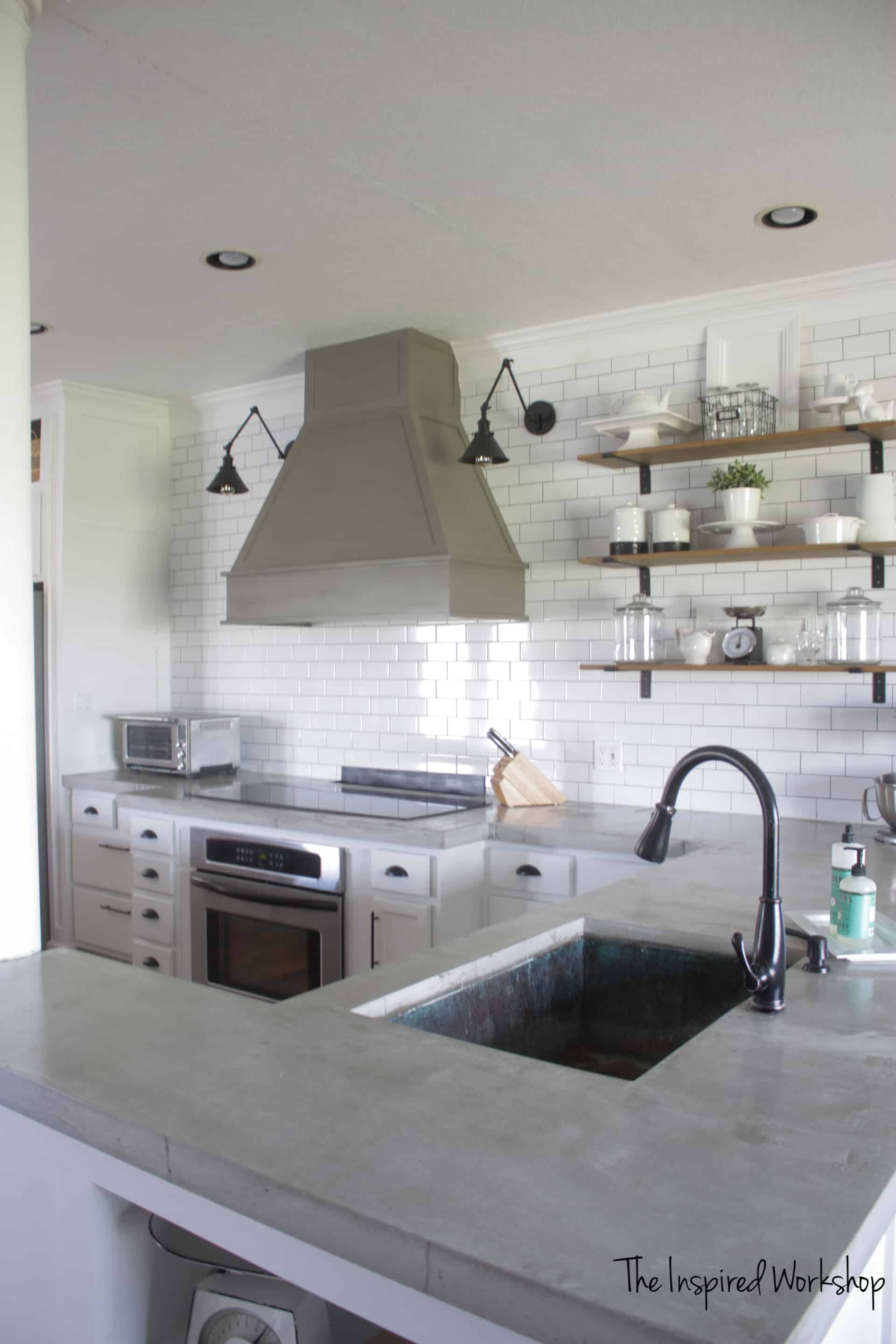 Kitchen with white subway tile and concrete countertops