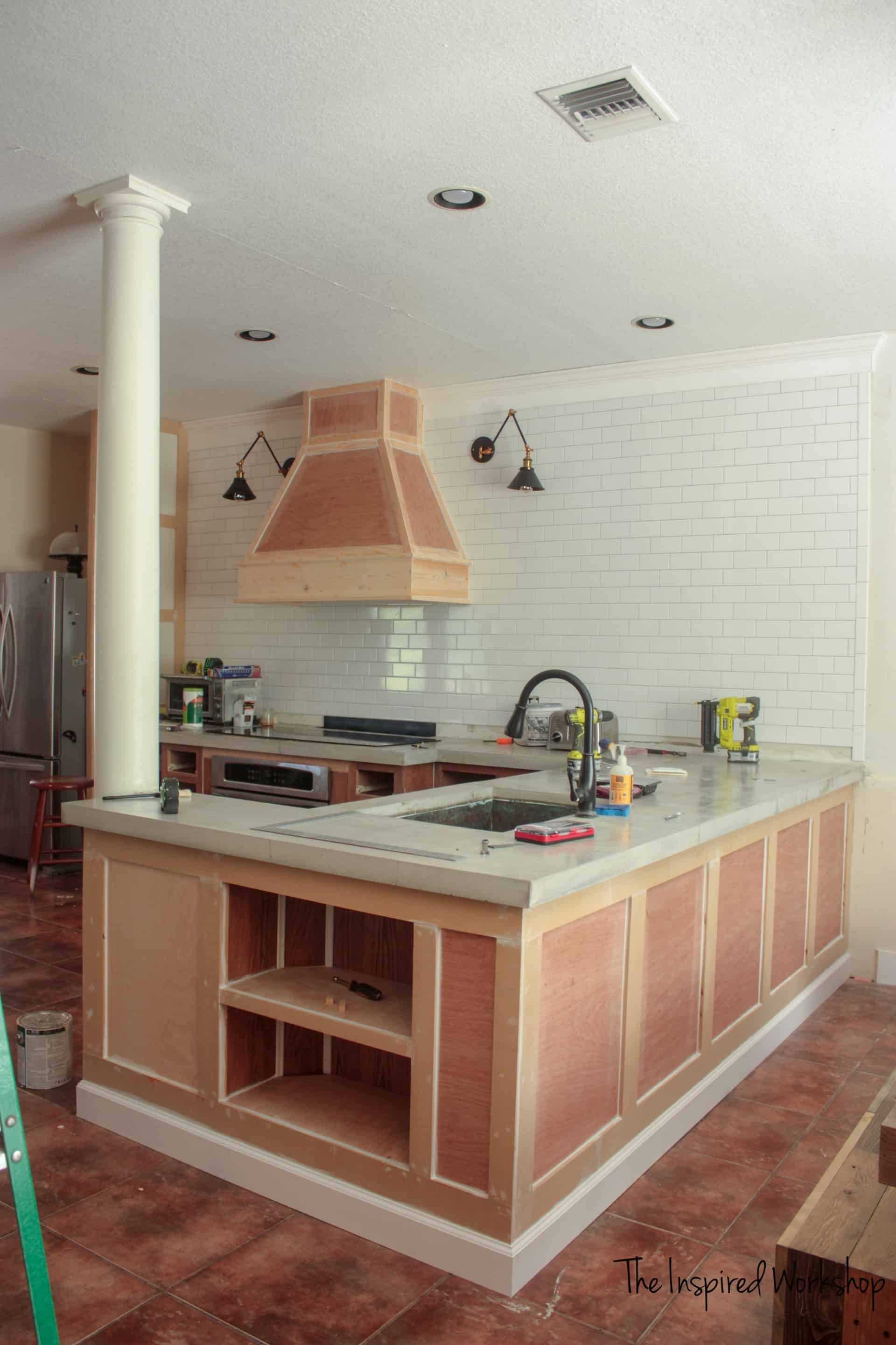 Extending the cabinets and building out the peninsula - kitchen renovation
