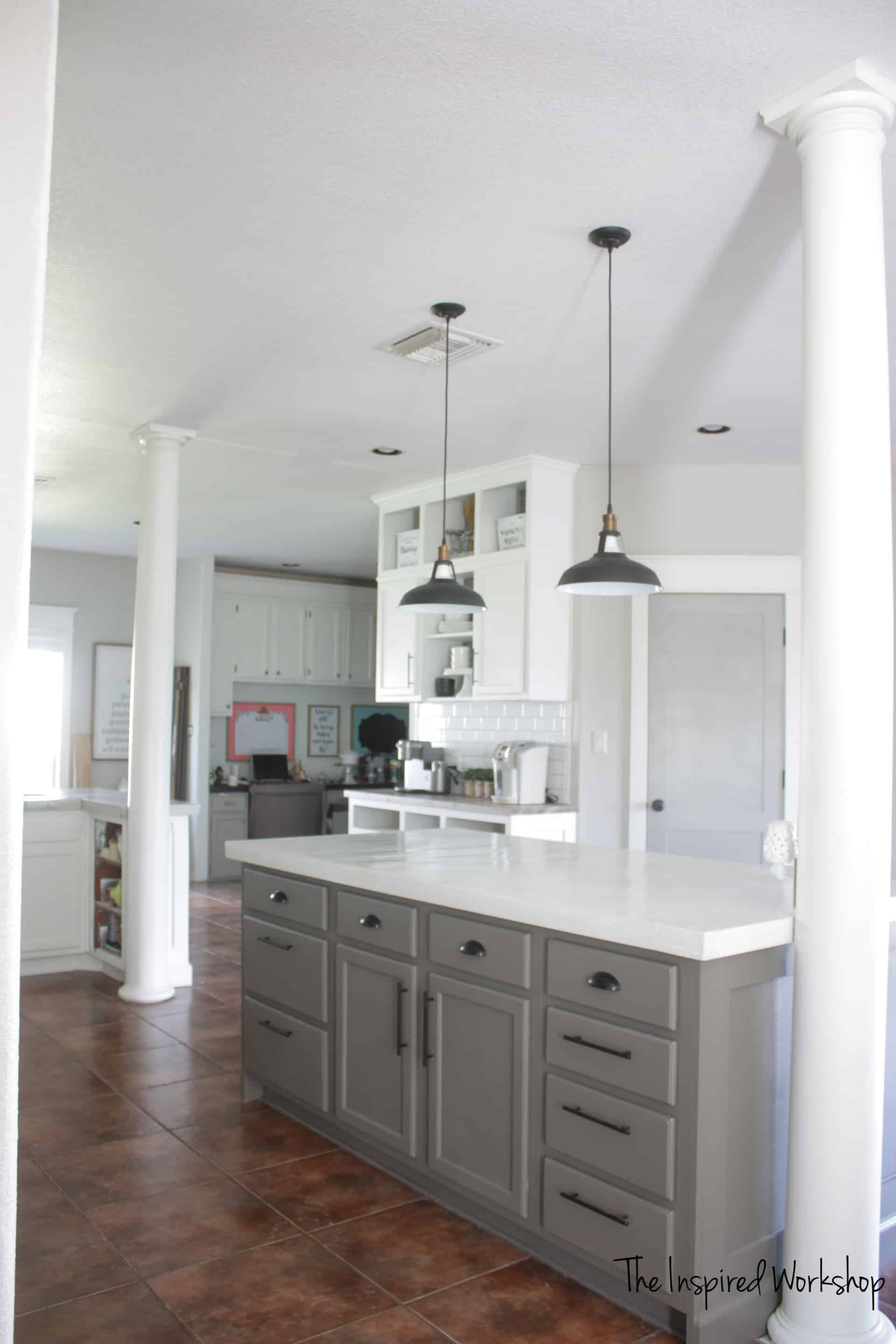 DIY Kitchen Renovation - Kitchen remodel completed on a budget and og beautiful white and gray cabinets along with subway tile and swing arm lampS!