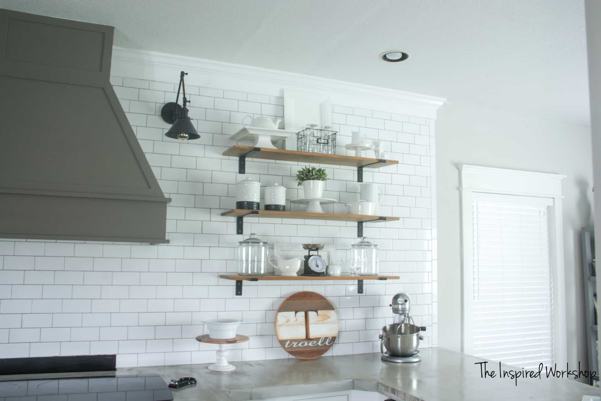 Kitchen Remodel with open shelving and subway tile wall