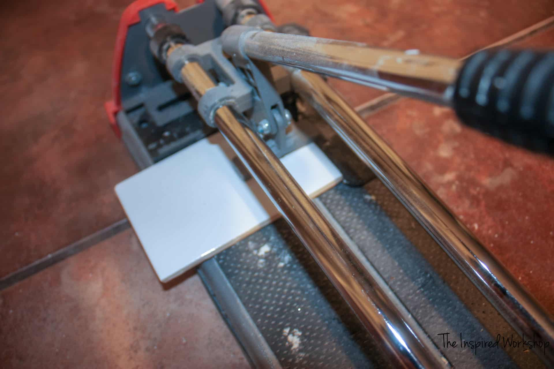 Using a tile cutter to cut tile