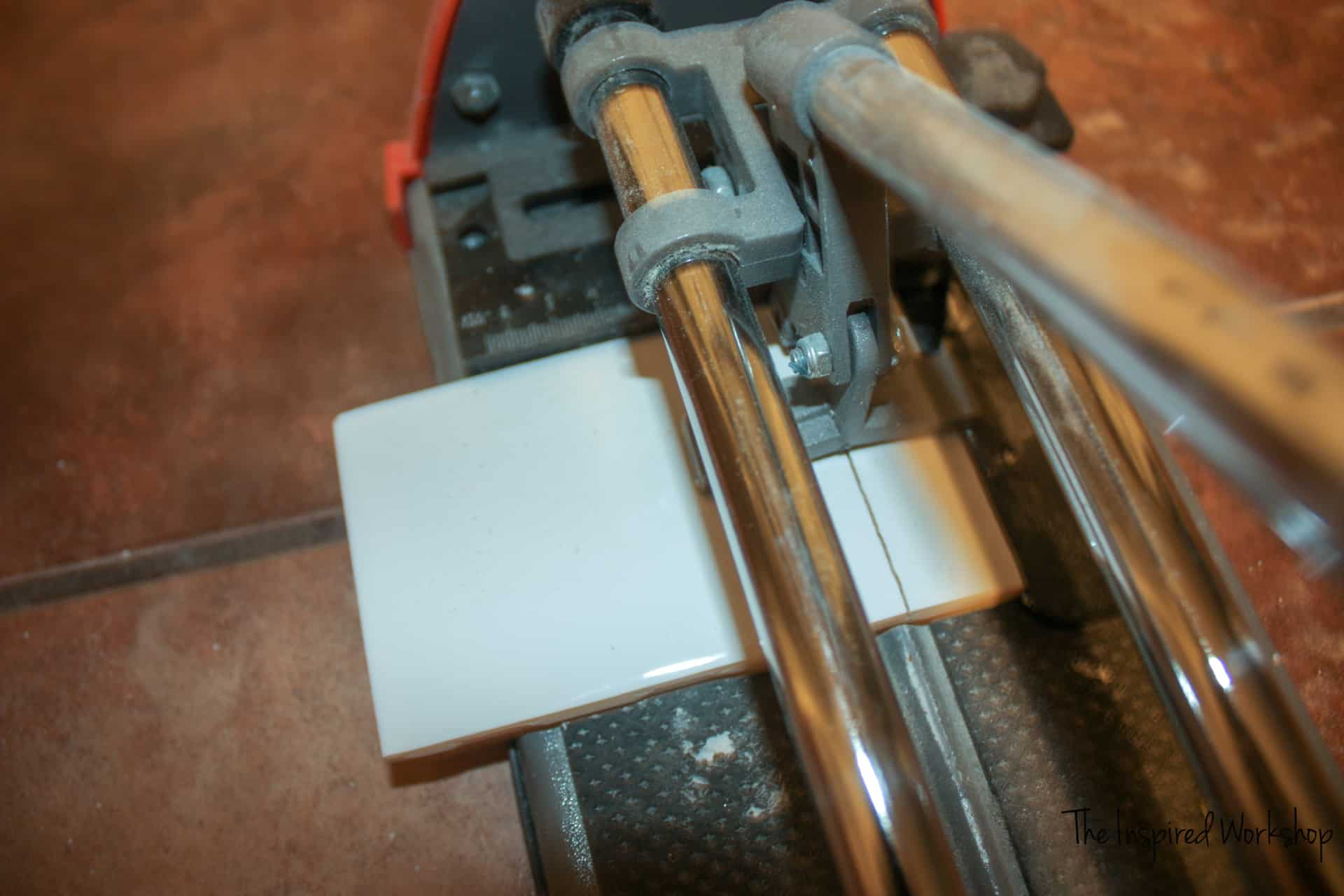 Cutting tile with a tile cutter