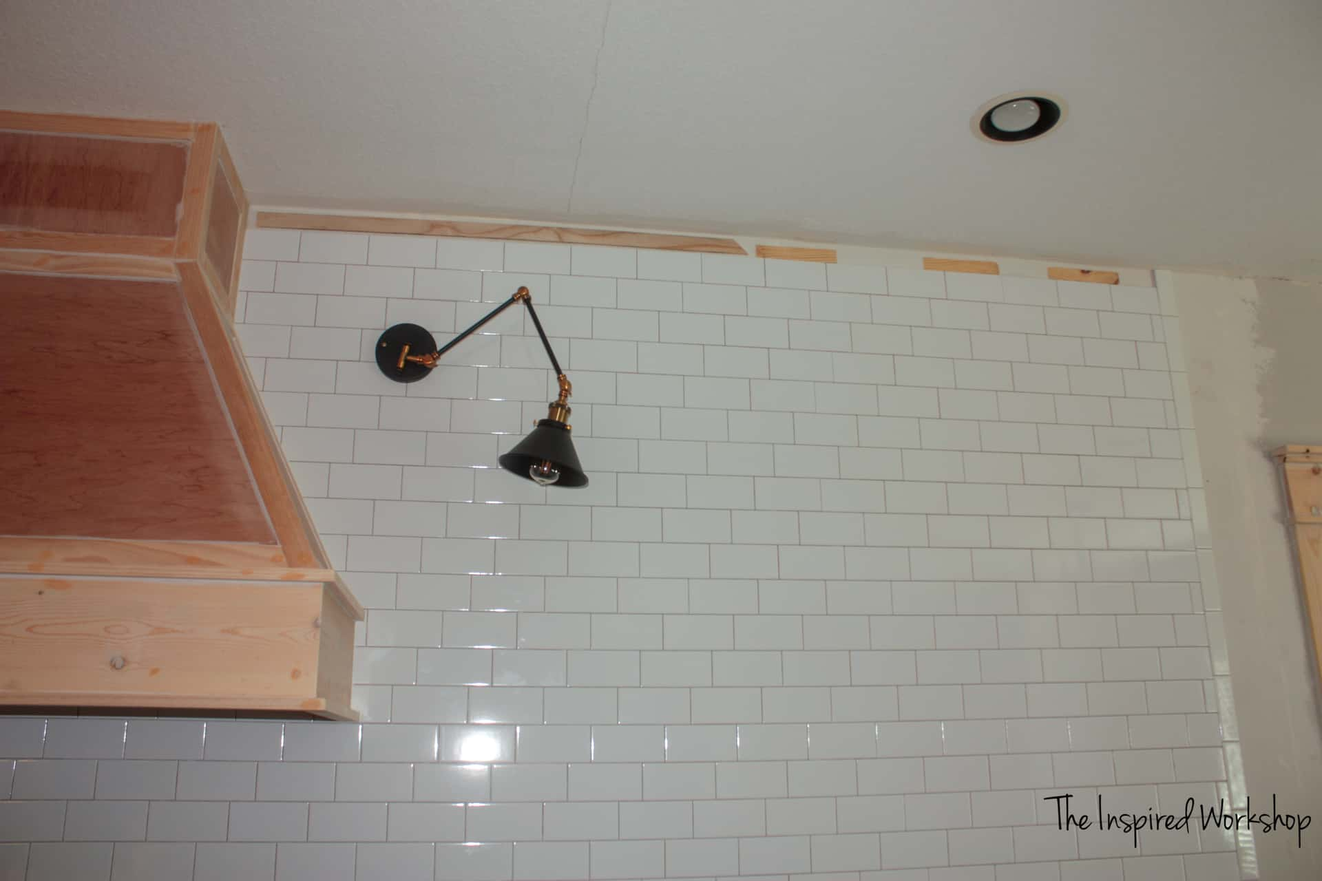 Tiling a wall with an uneven ceiling