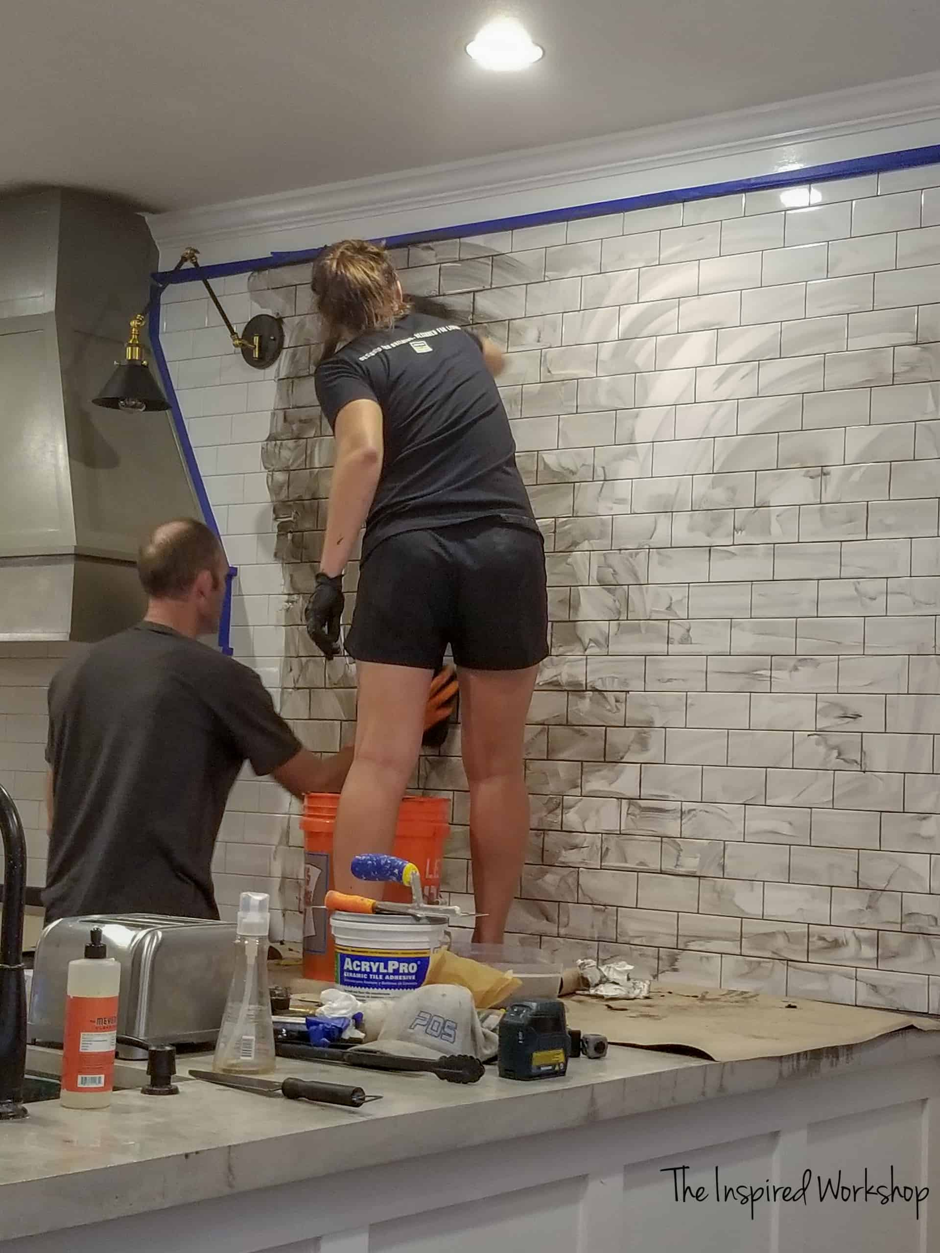 Grouting a kitchen wall