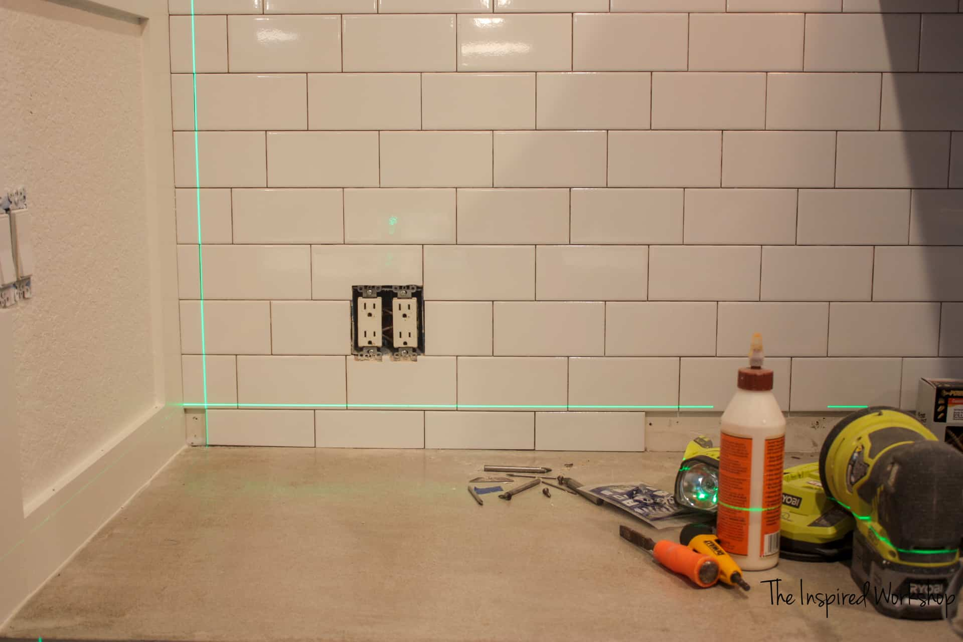 Using a laser level to get tiles straight