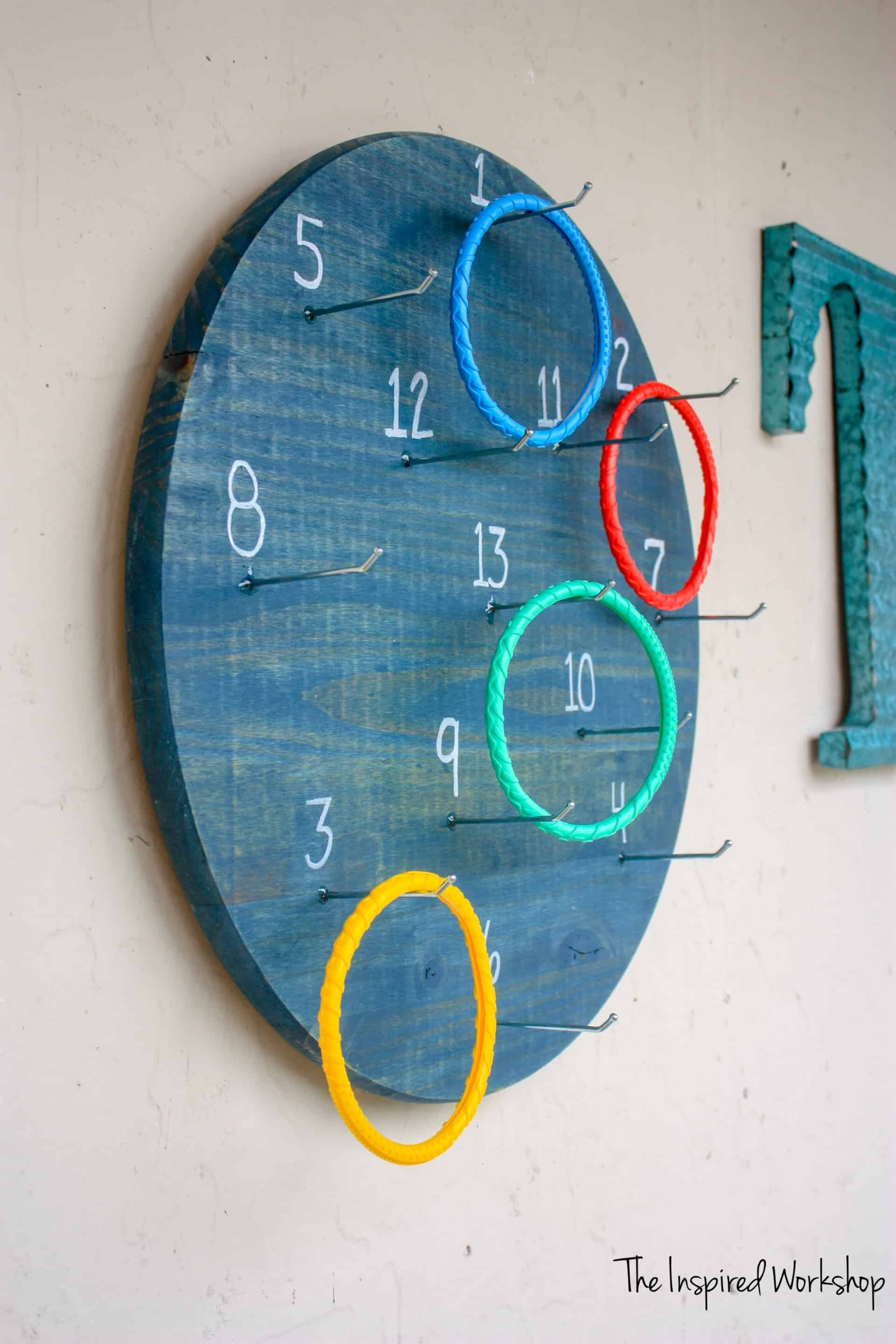 DIY Ring Toss Game - A twist on the classic game where you throw the rings at the wall mounted pegs!