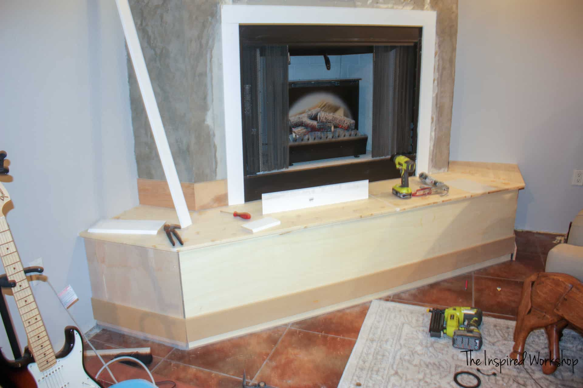 Fireplace Makeover - Adding the trim molding and baseboards