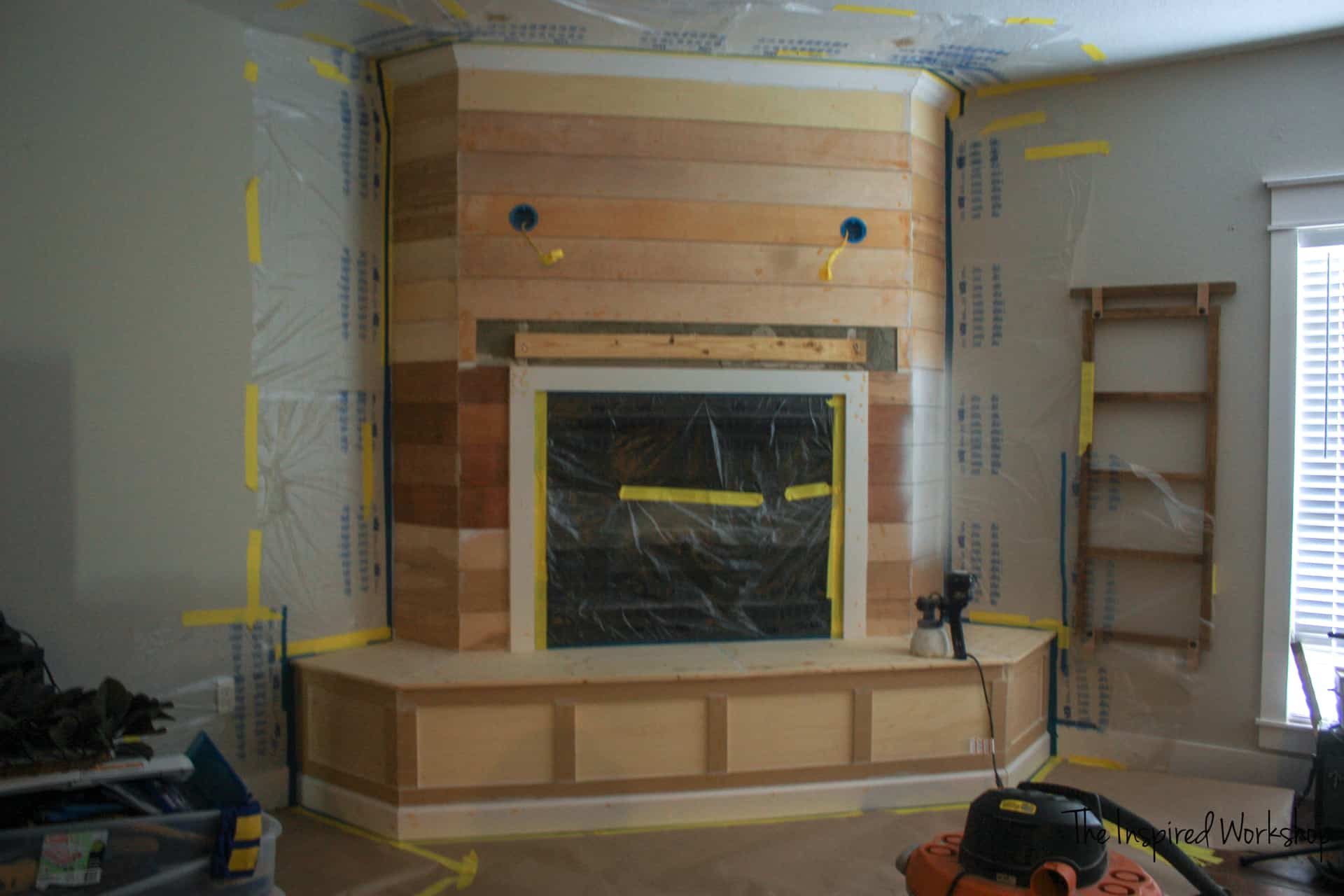 Fireplace Makeover - painter's tape in place and ready to spray paint
