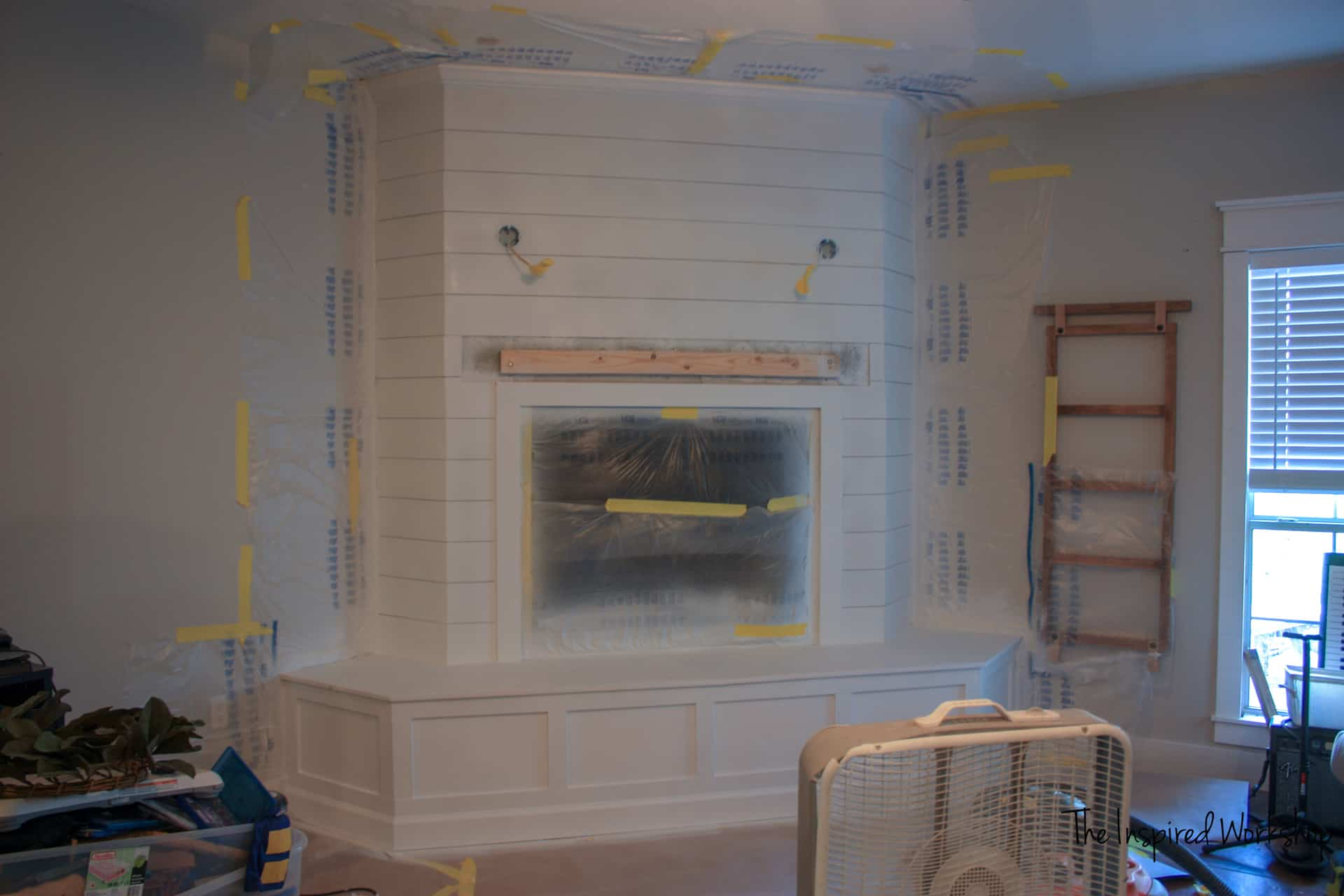 Fireplace Makeover - Primer sprayed