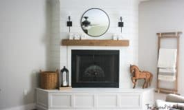 DIY Fireplace Makeover - Shiplapped the top of the fireplace and created molding around the hearth to cover the concrete that was beneath!