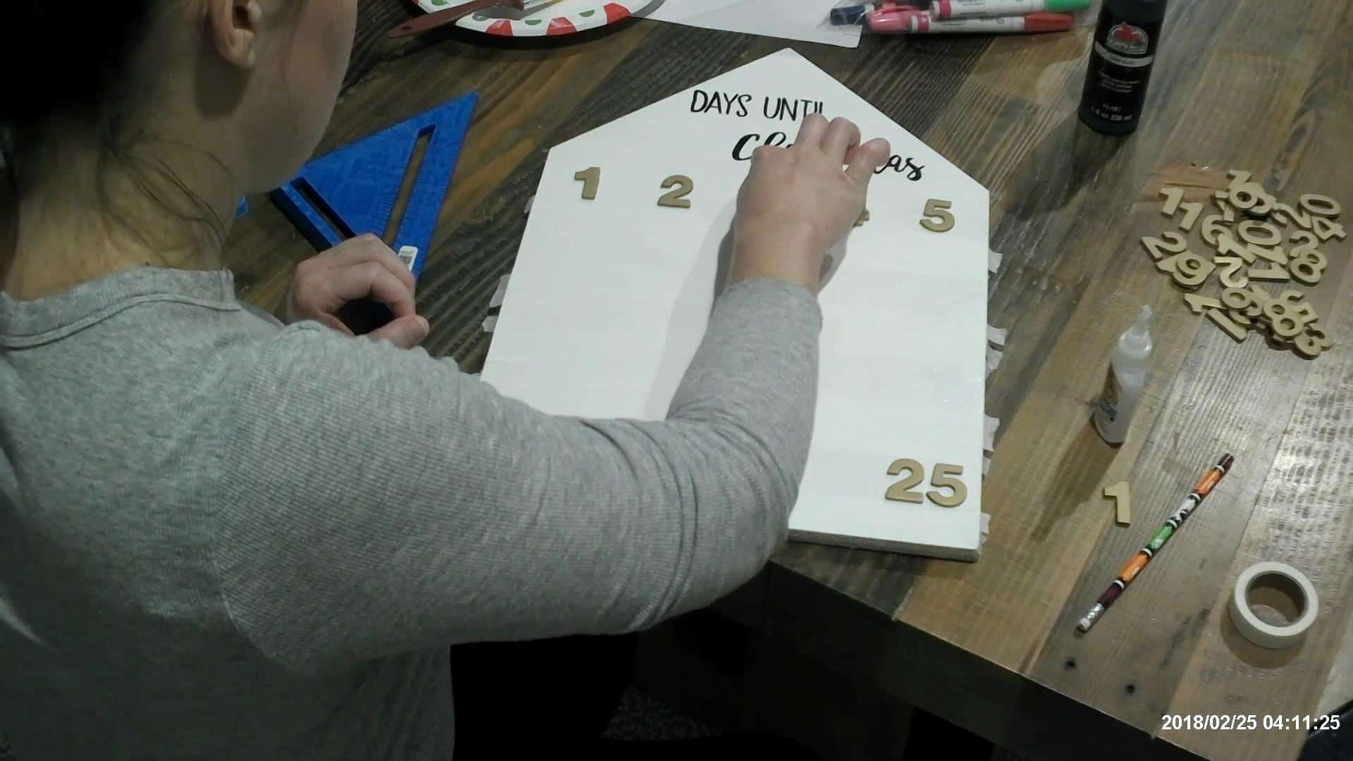 Adding the numbers to the advent calendar board