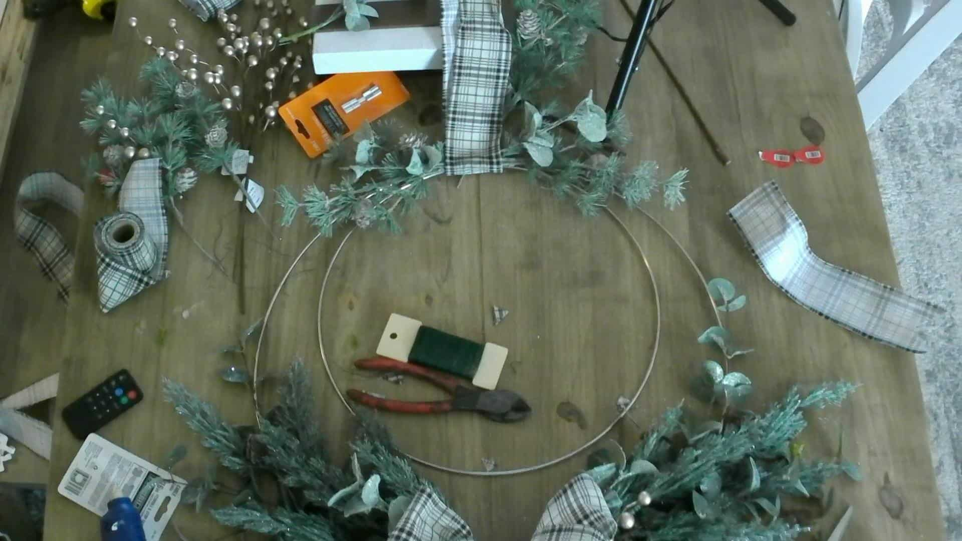 Adding the stems to the top of the DIY Christmas Wreath
