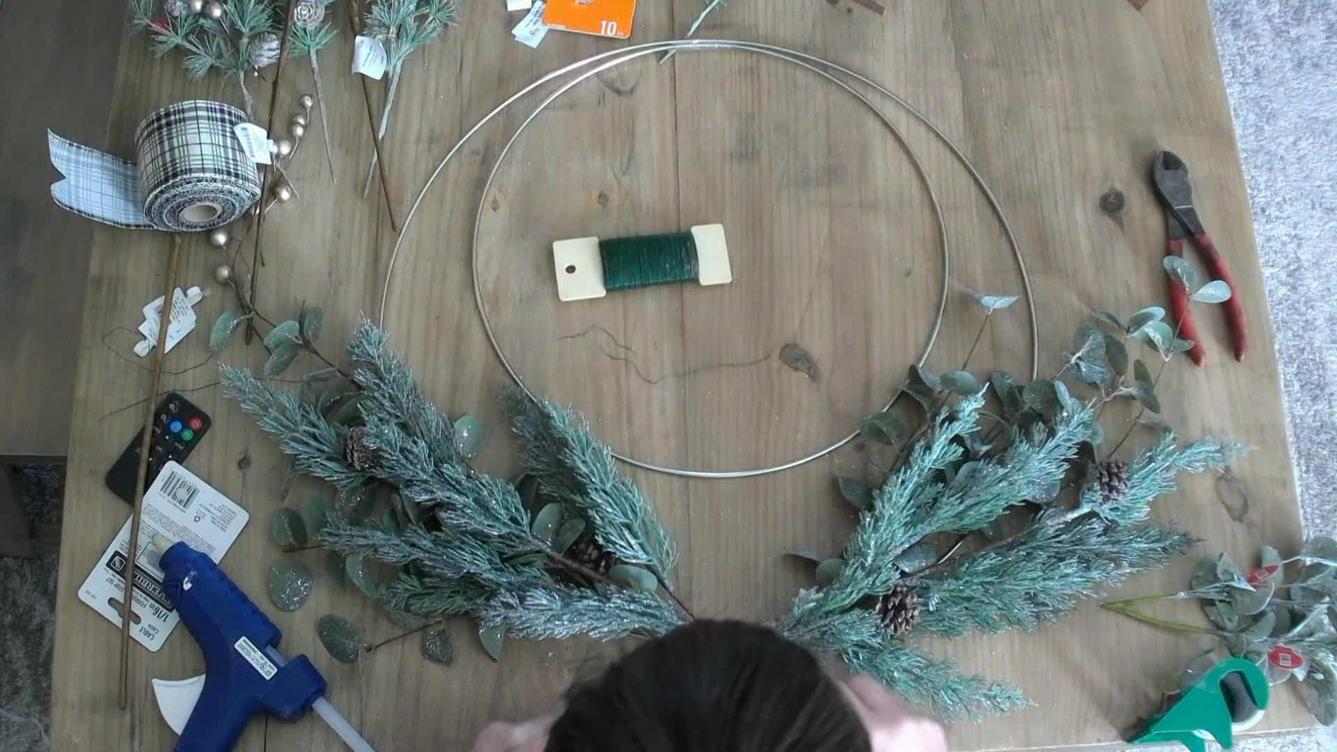 Adding Eucalyptus and pine to the christmas wreath