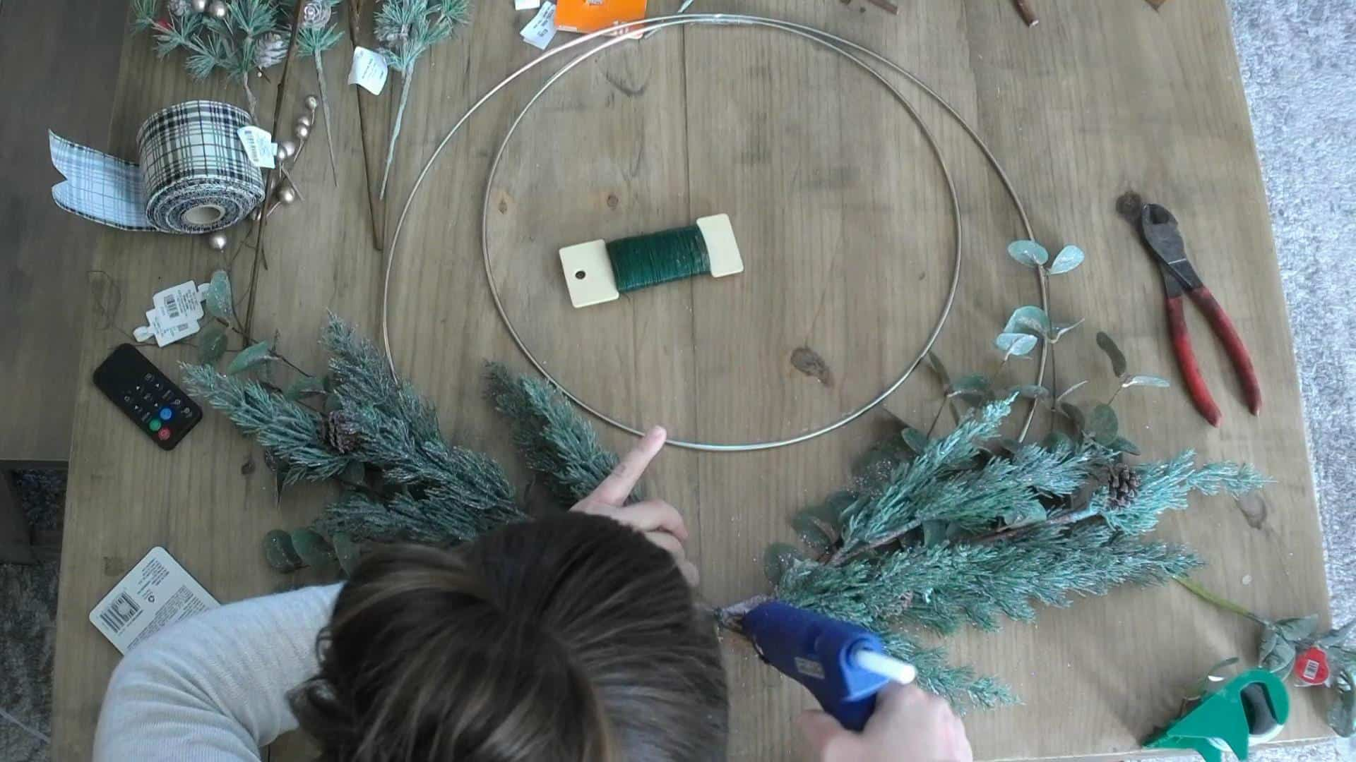 Hot gluing the DIY christmas wreath
