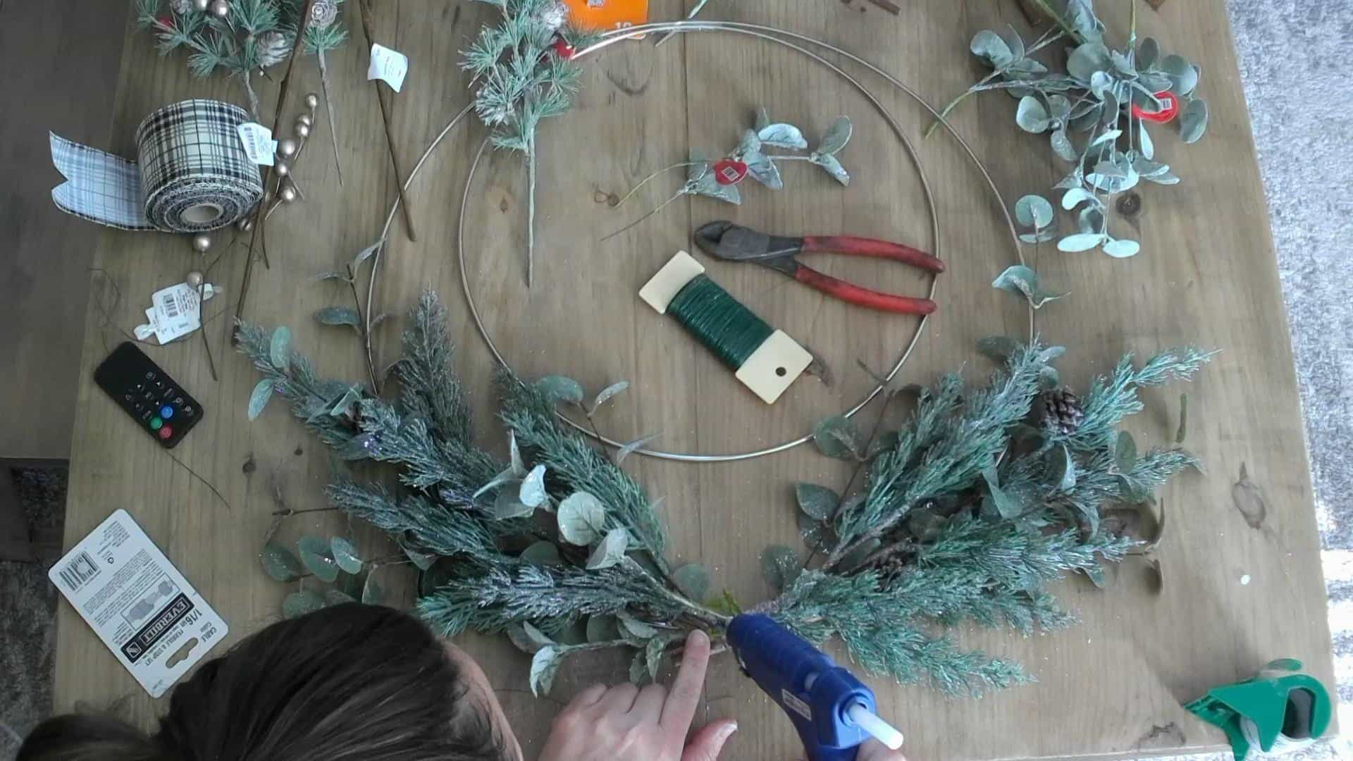 Making the DIY Christmas Wreath with metal hoop