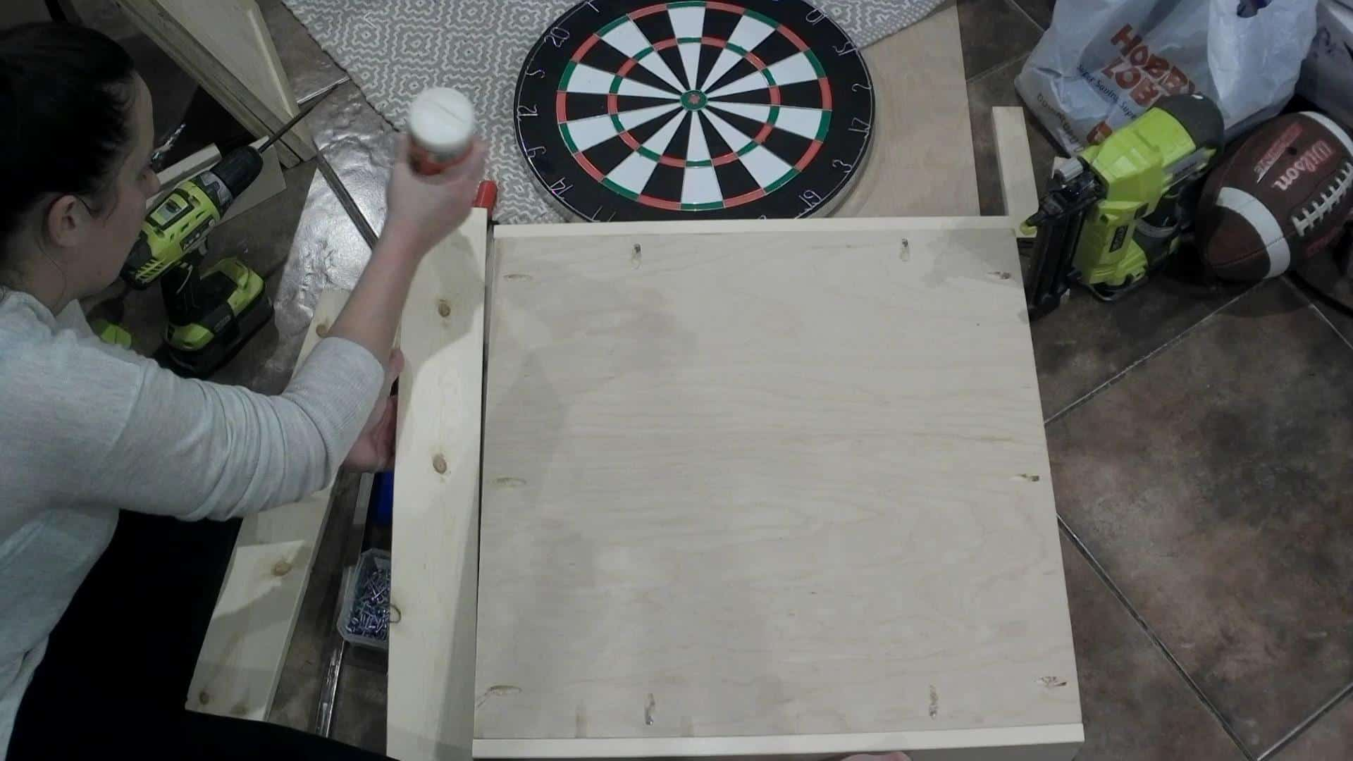 Glueing the frame on the DIY dartboard cabinet