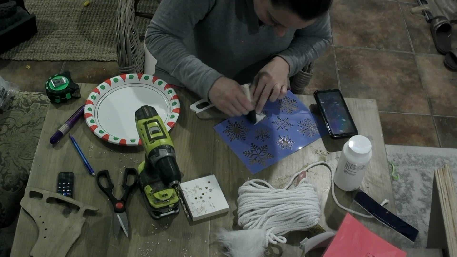 DIY Ice skate decor - painting the snowflakes on the ice skates