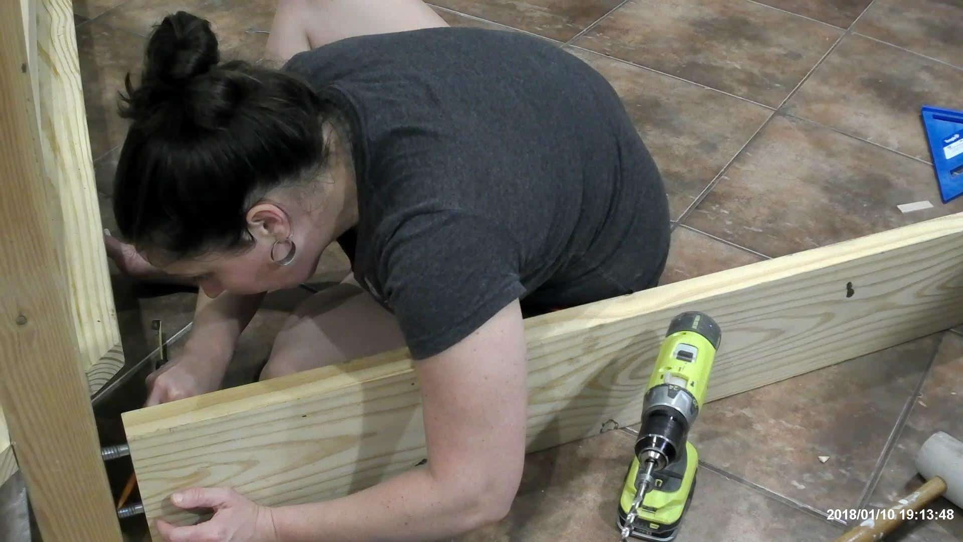 Installing the bed frame hardware on the DIY queen bed frame