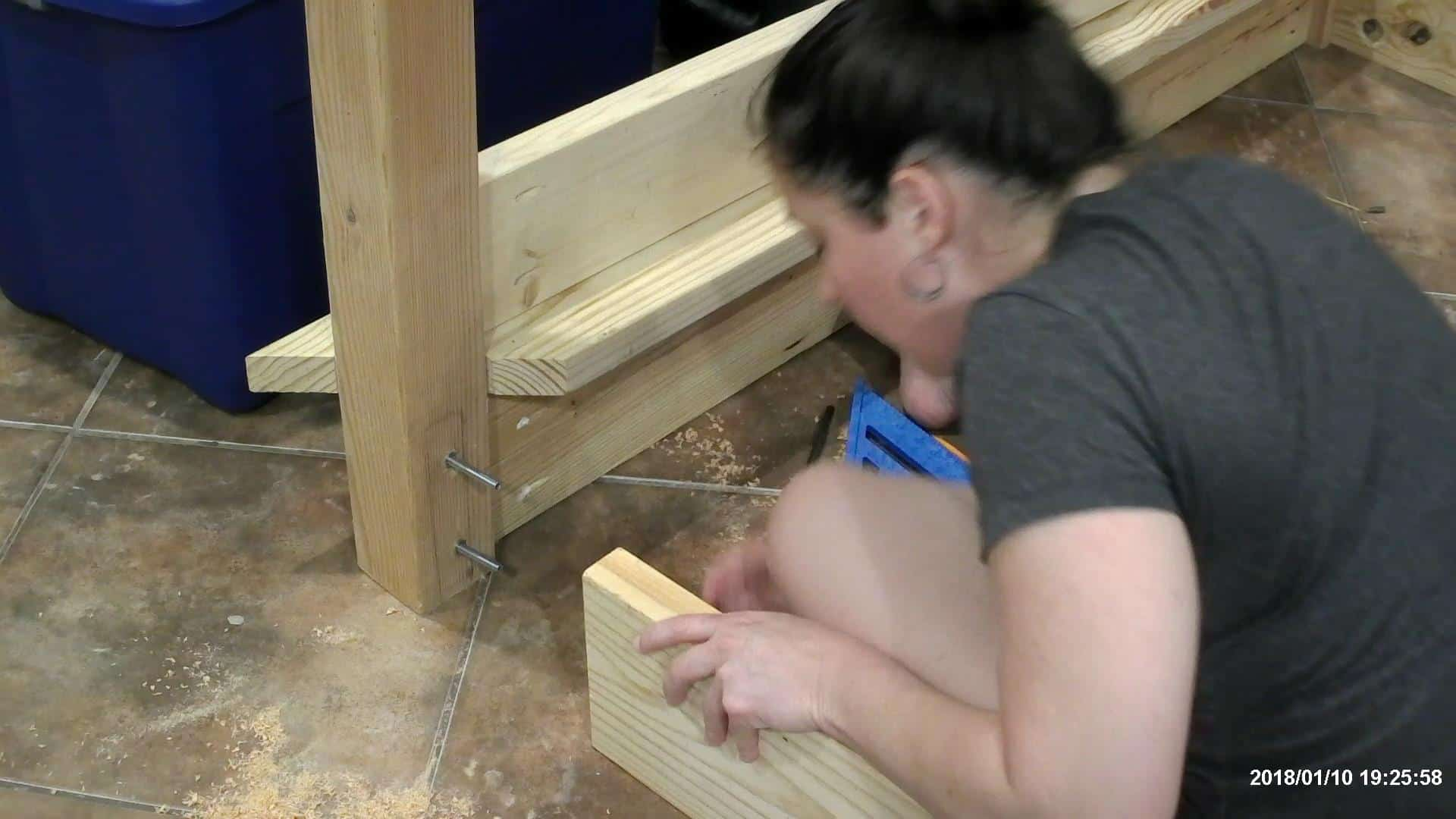 Adding the bed rail hardware to the DIY queen bed frame