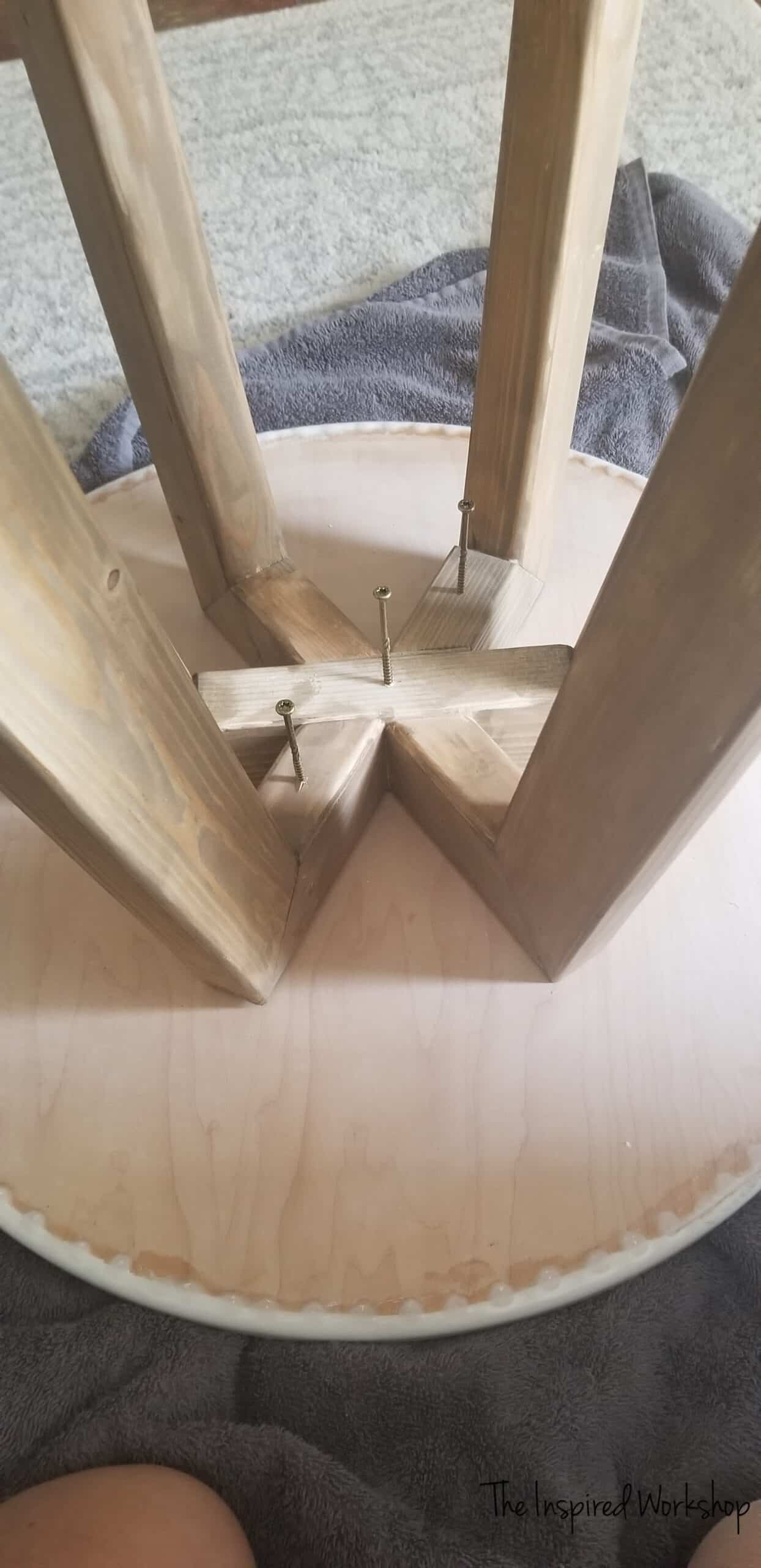 Attaching the base of the table to the top of the table
