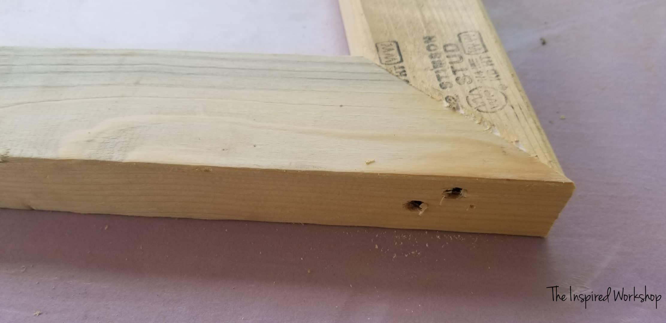 Hidden screws along the bottom of the main leg